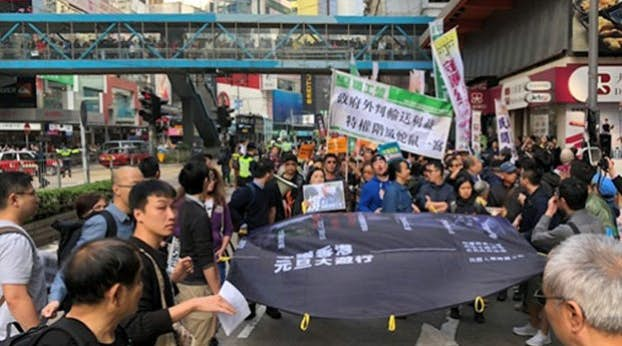 Thousands in Hong Kong protest Beijing's interference